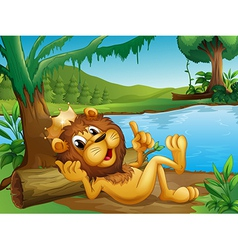 A king lion lying in a trunk at the riverside vector image