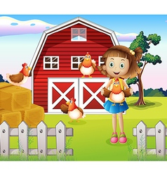 A girl holding a chicken at the farm vector