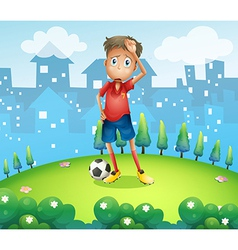 A tired soccer player at the top of the hill vector