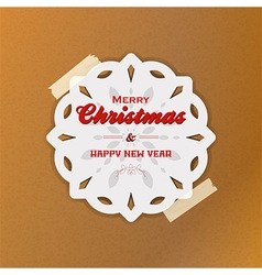 Christmas snowflake with sellotape on brown paper vector