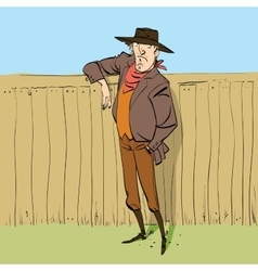 Cowboy in full figure standing near a fence vector image vector image