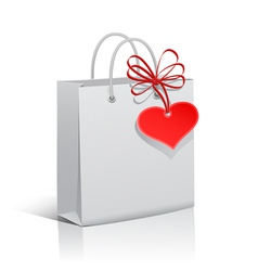 Paper bag with red heart tag vector image