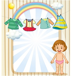 A baby below the hanging clothes vector