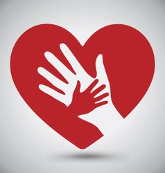 Helping hands on red heart vector