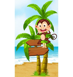 A playful monkey above the wooden arrowboard at vector image