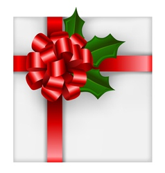 Christmas gift with red bow and holly vector image vector image