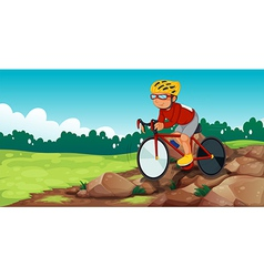 A boy biking at the rocky road vector