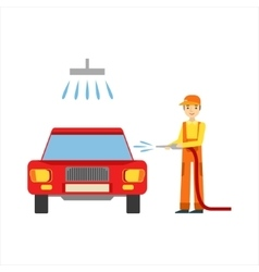Smiling mechanic washing the car in the garage vector