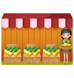 A girl selling pineapples vector image