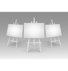 White Wooden Easels with Empty Blank Canvases vector image