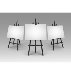 Black wooden easels with mock up canvases isolated vector