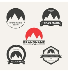 Set of emblems associated with mountains vector