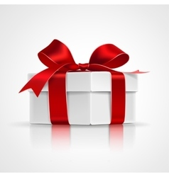 Gift with red bow vector