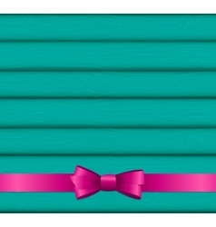 Pink ribbon and bow on wooden background for vector