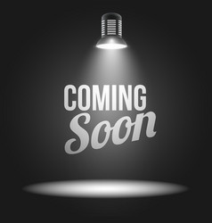 Coming soon message illuminated with light vector