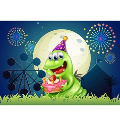 A carnival with a monster holding a cake vector image