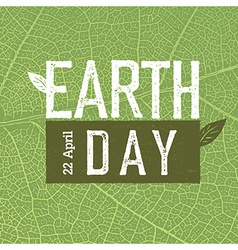 Grunge earth day logo on green leaf veins texture vector