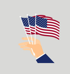 hand holding american flags vector image vector image