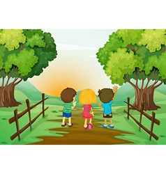 Three kids watching the sunset vector image