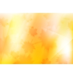Blurred orange autumn background with maple leaves vector