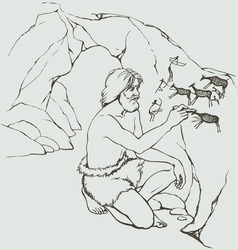 Primitive man draws on stone wall of cave vector image