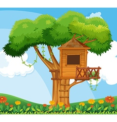 Nature scene with treehouse in the garden vector image