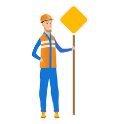 Young caucasian road worker showing road sign vector