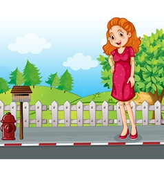 A woman at the roadside near the wooden mailbox vector
