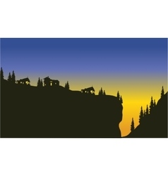 Silhouette of trees on the cliff vector