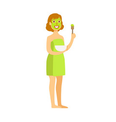 Woman standing with green face mask applied to her vector