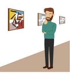 Young man in gallery looking at abstract paintings vector