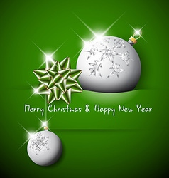 Simple green christmas card with bow and bauble vector image