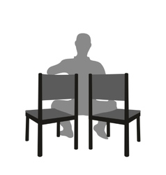 Silhouette of a man sitting in a two chair vector