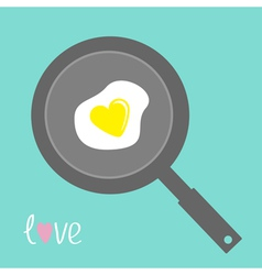 Egg in shape of heart on the frying pan vector image vector image