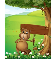 A beaver standing under the tree with an empty vector image vector image