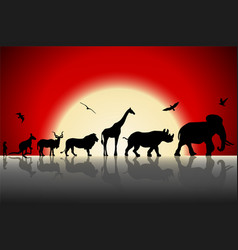 Silhouettes of wild animals on red sunset vector