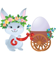 Easter bunny with a small cart and an egg vector
