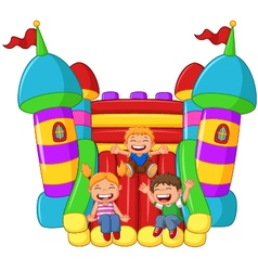 Cartoon little kid playing slide on the inflatable vector