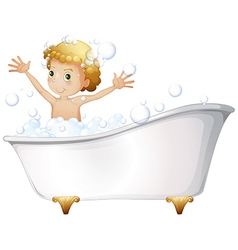 A young boy taking a bath at the bathtub vector