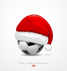 Santa hat on soccer ball vector image