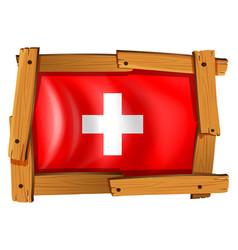 swiss flag in wooden frame vector image