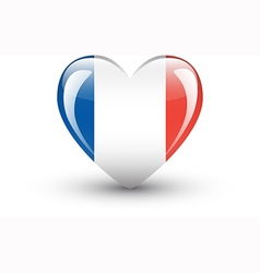 Heart-shaped icon with national flag of france vector