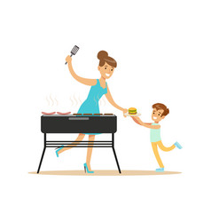 Mother with her son preparing sausages and burgers vector