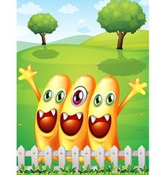 Three happy orange monster near the fence vector