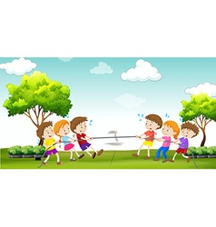 Children play tug of war in the park vector image