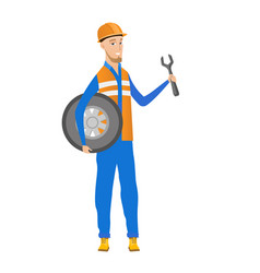 young caucasian mechanic with tyre and spanner vector image