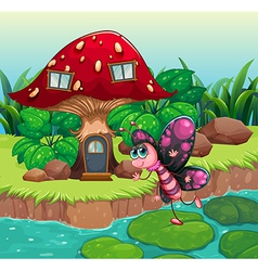 A butterfly waving near the red mushroom house vector image