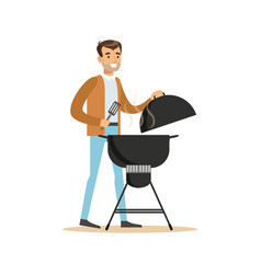 Smiling man preparing barbecue on a grill vector