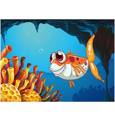 A smiling fish under the sea inside the cave vector image