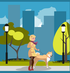 Young woman walking a dog vector